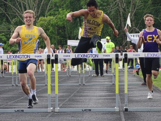 Bloom-Carroll senior Kenneth Sherman attacks the final hurdle Saturday in the 300 hurdles during the Division II regional meet at Lexington. Sherman placed fourth in a time of 39.70.