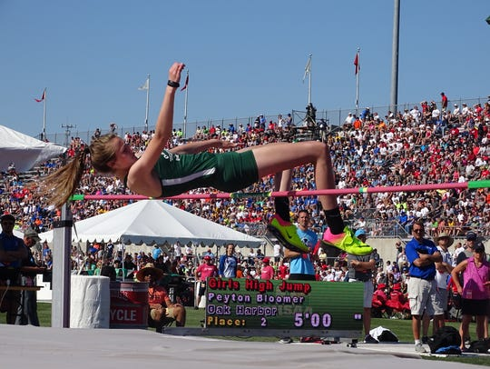 Oak Harbor's Peyton Bloomer  tries to clear the bar