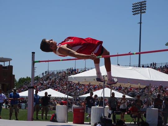 Piketon's Timothy Trawick clears the bar in the high jump during the Division III state track tournament Friday at Jesse Owens Memorial Stadium. Trawick won the high jump title by clearing 6-feet-8.