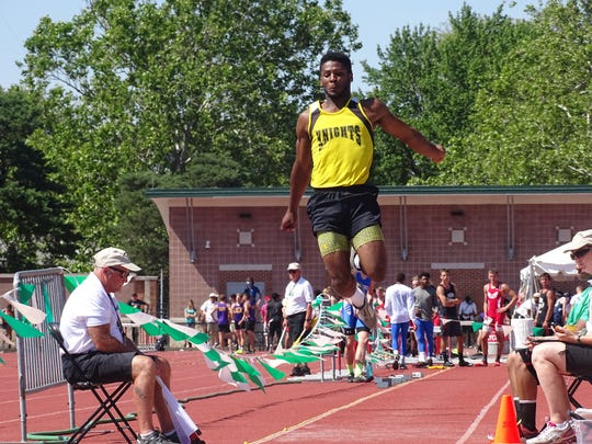 Northmor junior Demetrius Johnson wins his second DIII long jump title in three years.