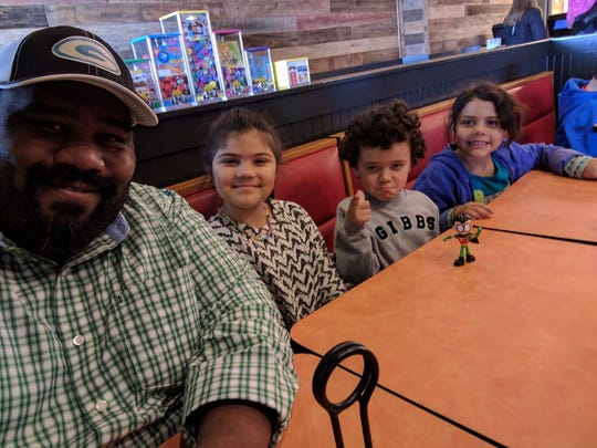 James Spears enjoys lunch with the three youngest of his six children: Shelby, 9; Andrew, 4; and Katie, 7.