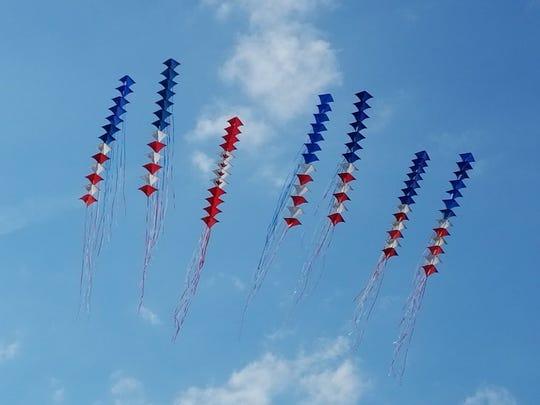 Windjammers Stunt Kite Team display their aerial artistry choreographed to popular and patriotic music.