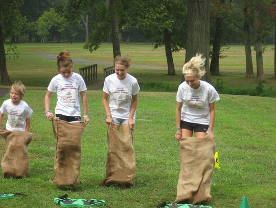 Family members compete in a Sack Race as part of the