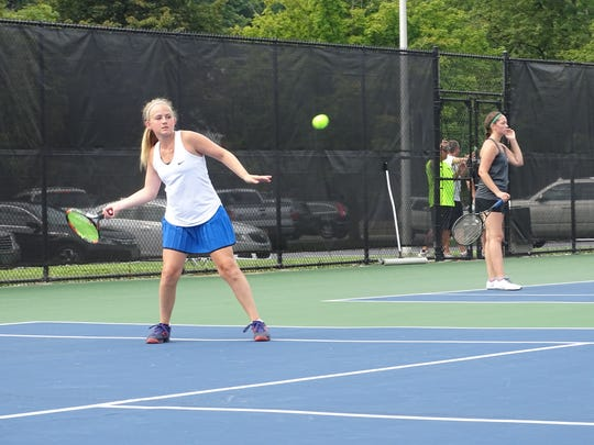 Granville freshman Olivia Eckels prepares to hit a forehand in her No. 2 singles match during the Licking County Tournament this past Friday at Denison University.