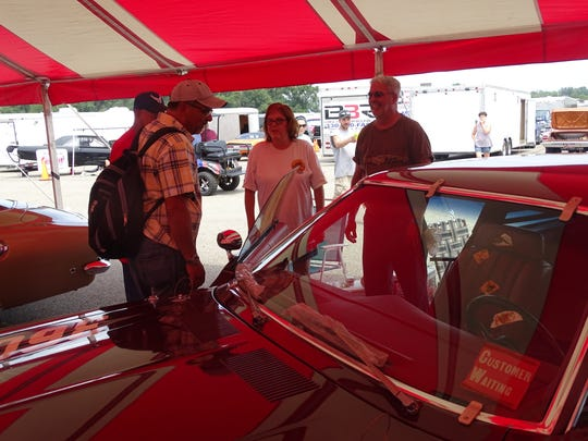 Jerry Harris, right, of Alton, Illinois, and his wife Margaret talk to fans about their 1978 Dodge Aspen Street Kit Car on Friday during the Mopar Nationals at National Trail Raceway.