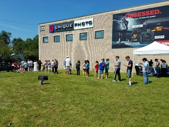 The line for solar eclipse viewing glasses wrapped
