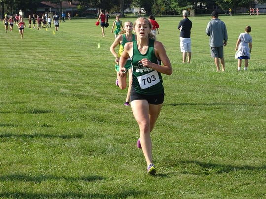 Northridge junior Megan King, front, and Newark Catholic sophomore Charlotte Campbell near the finish line Saturday during the Newark Catholic Invitational.