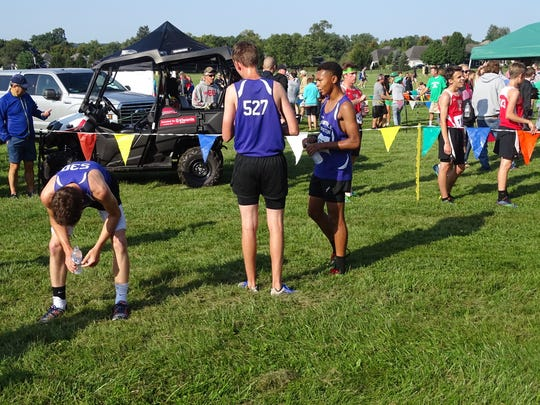 Granville Christian sophomore Thomas Benvie, junior David Blacksten and freshman Ian Law catch their breath this past Saturday after competing in the Newark Catholic Invitational held on the grounds of the Bryn Du Mansion.