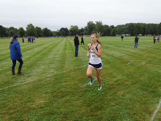 Granville senior Kylee McFarland nears the finish line this past Saturday in the Granville Invitational on the grounds of the Bryn Du Mansion.