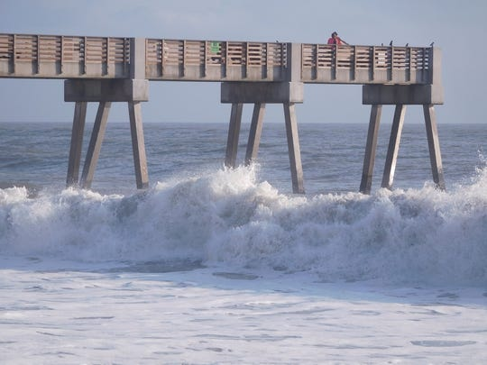 Waves pounded a pier in Vero Beach Sunday, Sept. 17, as Hurricane Jose passed offshore, stirring up rough surf