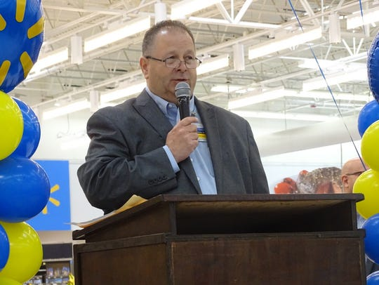Walmart store manager Steve DeVolld thanks employees