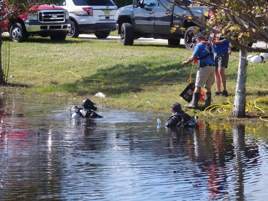Divers search a lake near Lackawanna Street for missing 4-year-old Chelsea Noel.
