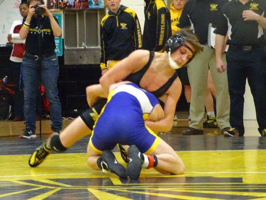 Watkins Memorial sophomore Mason Boyd fights off a shot attempt from a Reynoldsburg opponent during a 120-pound match on Dec. 7.