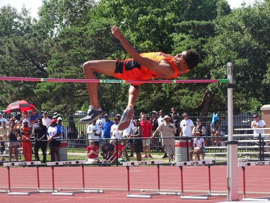 Mansfield Senior's Joe Ellis wins a Division I state high jump title by clearing 6-10.