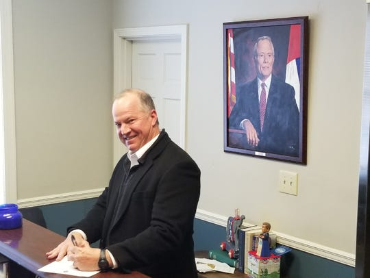 Perry Parker signs paperwork to qualify to run for