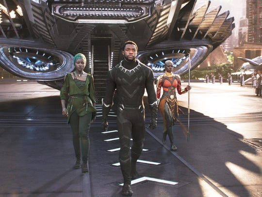 "As played by Chadwick Boseman (center), ""Black Panther"""