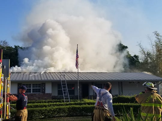 A Tuesday morning fire left a Palm City home with heavy damage and sent one person to a hospital with minor injuries.