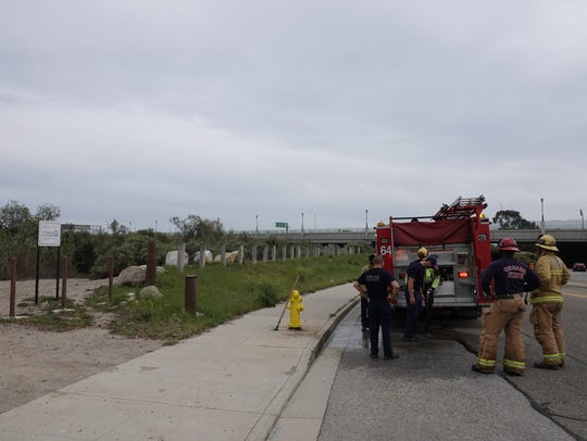 Oxnard firefighters hose off after searching the river