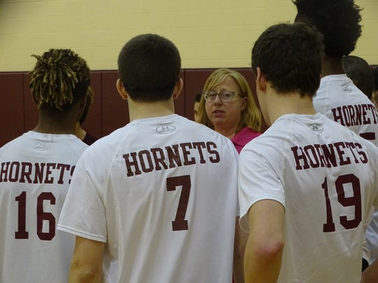 Licking Heights coach Tina Cox talks to the Hornets during a timeout April 17 during a match against Northland.