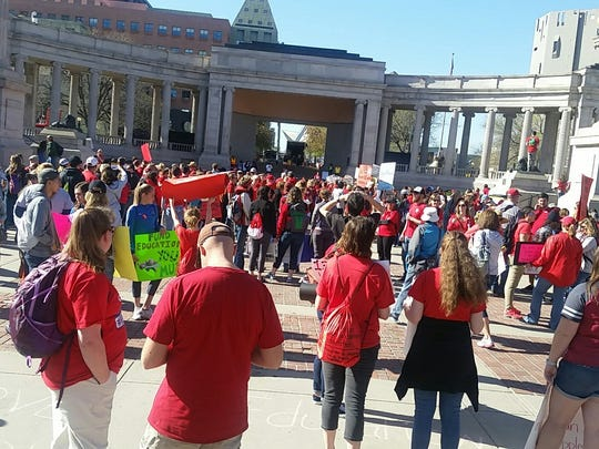 A crowd of people wearing #RedforEd shirts starts gathering