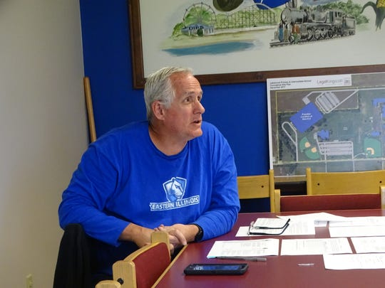 Lakewood board member Bill Pollard talks to his colleagues during Sunday's work session to discuss a plan to replace Bill Gulick, who resigned April 19.