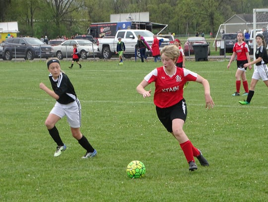 Joelle Baker, of XTABI U13, leads a counter attack against Clear Fork on Sunday during a Buckeye Cup match at Alford-Reese Park.
