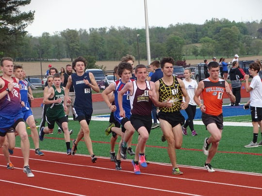 Watkins Memorial junior Bryce Small races at the front of the pack of the 1,600 this past Friday during the Licking County League championships at Lakewood.