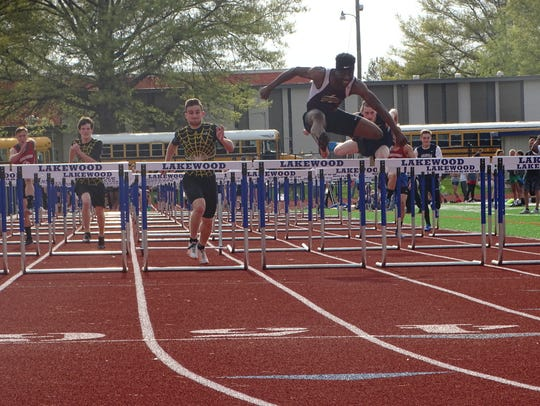 Licking Heights senior Victor Adebayo leads the 110 hurdles this past Friday during the Licking County League-Buckeye Division finals at Lakewood.