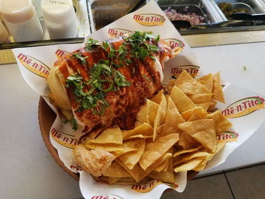 The smothered deep fried burrito is one of the menu options at the fast-casual Mexican grill Me-N-Tito's in Fort Myers.