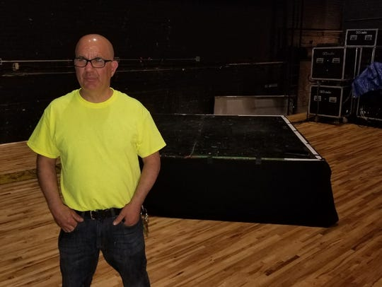Majestic Theatre owner Dave Zainea stands on the theater's