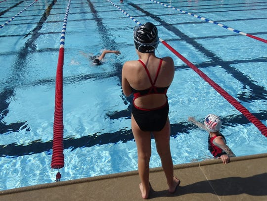 Grace Couzins, 8, nears the end of her leg of the 100