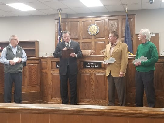 (L to R) Outgoing magistrates Bruce Todd, Charles Alexander and George Warren are presented plaques in honor of their service, by County Judge Brad Schneider.