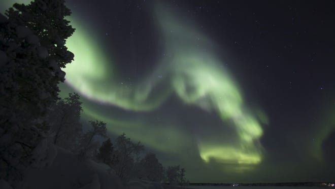 A picture taken on Dec. 25, 2017 shows northern lights (aurora borealis), illuminating the sky of Finnish Lapland in Inari.