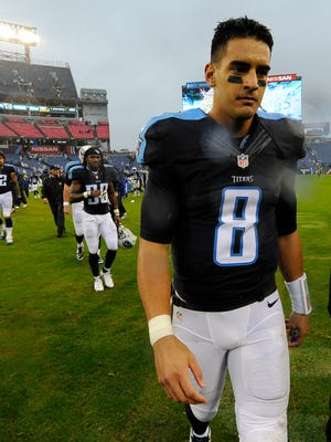 Titans quarterback Marcus Mariota (8) looks dejected after the game at Nissan Stadium Sunday Nov. 29, 2015, in Nashville, Tenn.