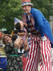 John Maurer of Ewing meets a young fan along the parade route as Randolph hosts their 42nd annual Freedom Festival and Independence Day Paradein 2017. The three-day festival begins Thursday night with a carnival, rides and entertainment and concludes Saturday with fireworks.