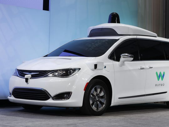 A Chrysler Pacifica is outfitted with Waymo LLC's self-driving system. The Google spinoff says it will invest up to $13.6 million in a new facility in Metro Detroit to integrate its technology into automaker partners' vehicles.