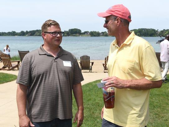 Michael Sotskopf, right, CEO of Michigan's Home Builders