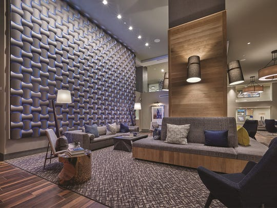 This stylish, two-story lobby is representative of