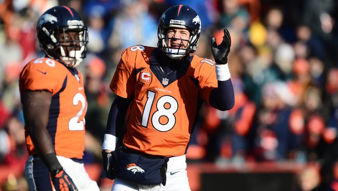 Dec 8, 2013; Denver, CO, USA; Denver Broncos quarterback Peyton Manning (18) calls to go for it on fourth down in the first quarter against the Tennessee Titans at Sports Authority Field at Mile High. The Broncos defeated the Titans 51-28. Mandatory Credit: Ron Chenoy-USA TODAY Sports