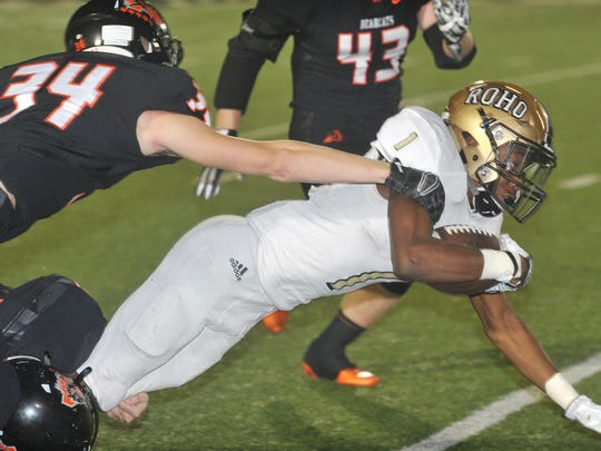 Rider's Samuel Manuel (1) lunges for extra yardage Friday night against Aledo in a bi-district playoff game.