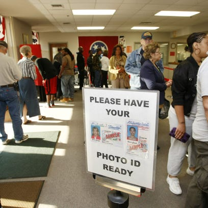 Voters wait in line on the first day of early voting
