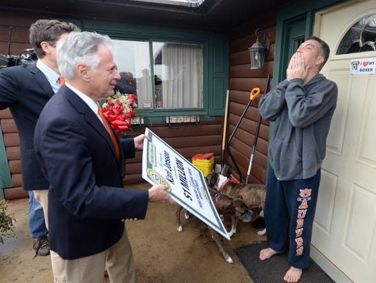 Karl Jonsson of Gresham, WI, right, reacts as Dave