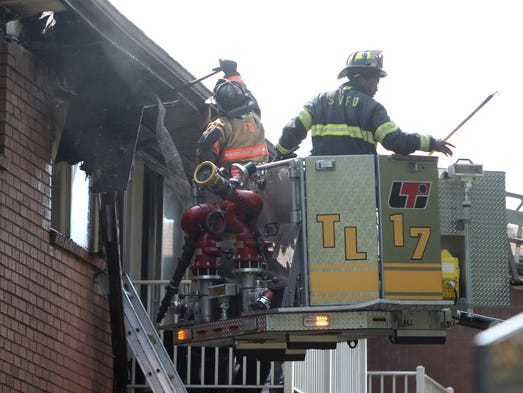 Firefighters work to control a fire at the Sleepy Hollow Gardens apartment complex on Lunney Ct. in Spring Valley Aug. 5, 2014.