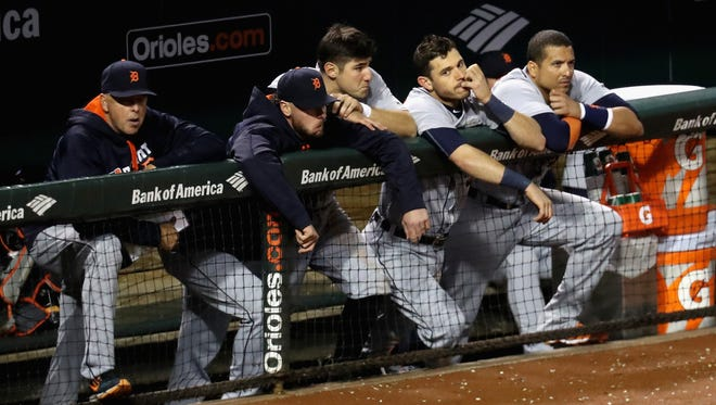 Members of the Detroit Tigers look on from the dugout in the ninth inning of their 9-3 loss to the Baltimore Orioles Saturday at Oriole Park at Camden Yards.