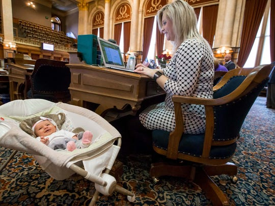 Rep. Megan Jones has her daughter, Alma Jones, at her House seat in the Iowa Statehouse Tuesday, Feb. 20, 2018, in Des Moines, Iowa. Rep. Jones gave birth to her on Jan. 24, 2018.