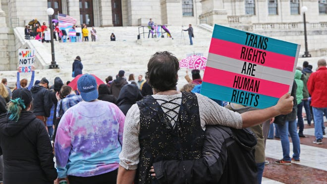 Activists stage a rally for transgender rights at the Rhode Island State House in November 2018. The Trump administration on Friday overturned Obama-era protections for transgender people against health-care discrimination.