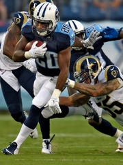 Titans running back Bishop Sankey (20) races up the