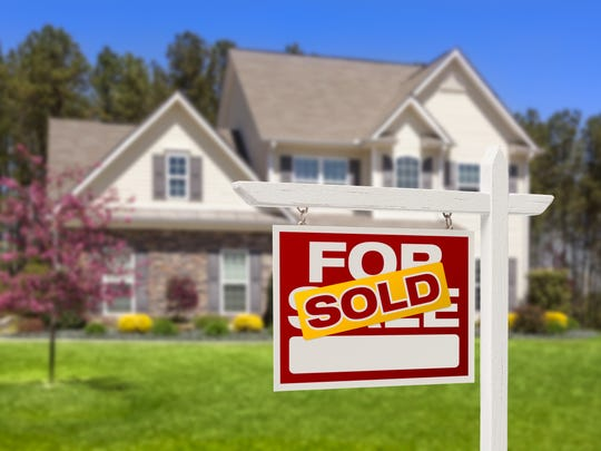 FILE PHOTO FROM GETTY IMAGES Sold Home For Sale Real Estate Sign and House