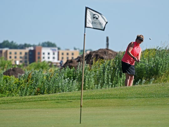 Pam Hoiland hits her ball onto the green on Elmwood