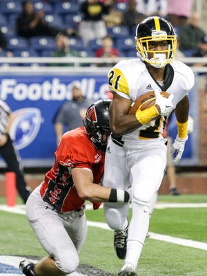 Detroit King's Lavert Hill scores a touchdown against Lowell at Ford Field in Detroit on Nov. 27, 2015.